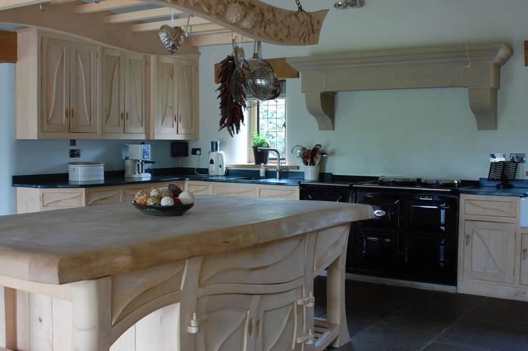 Manor house sculptural kitchen:  Kitchen by Carved Wood Design Bespoke Kitchens.