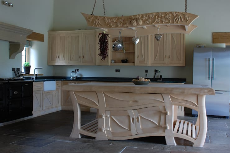 Manor house sculptural kitchen:  Kitchen by Carved Wood Design Bespoke Kitchens.