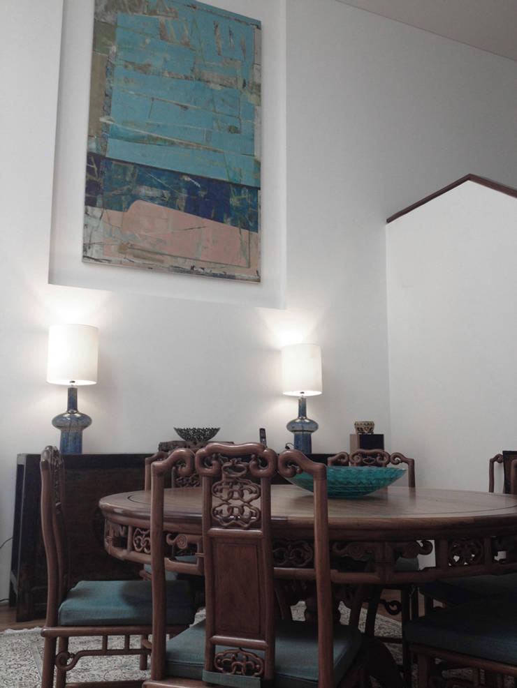 dining room:  Living room by elliot James Pte Ltd