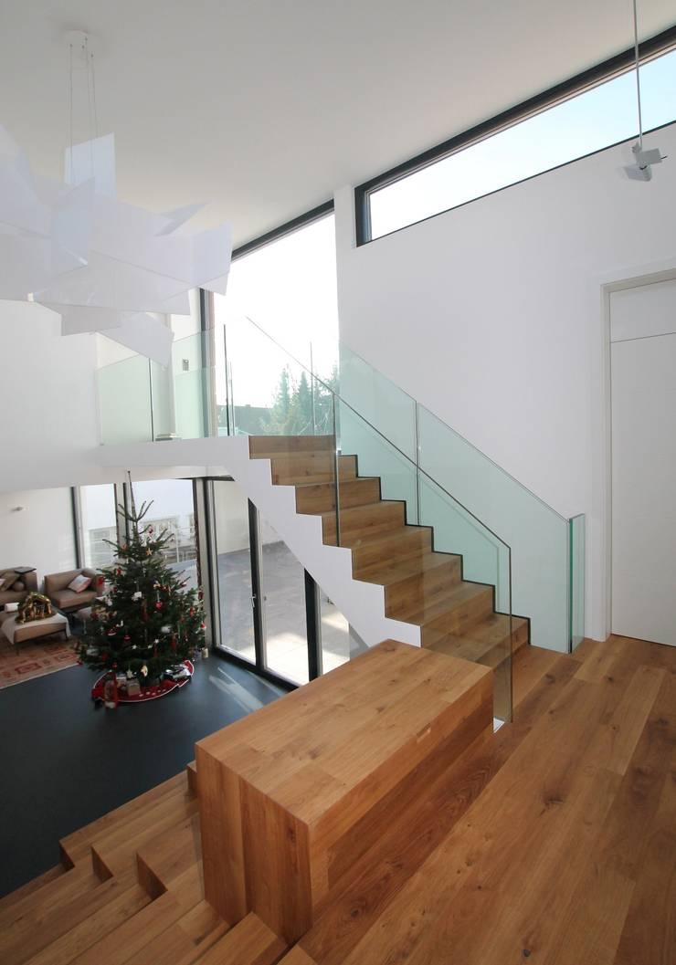 Casas de estilo  por Udo Ziegler | Architekten , Moderno