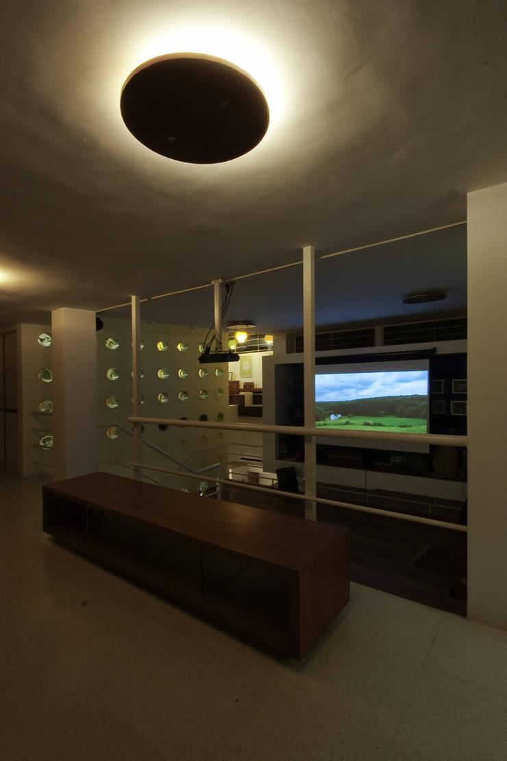 bridge overlooking the family room:   by Gaurav Roy Choudhury Architects