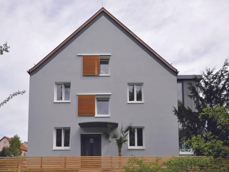Aus drei mach zwei:  Häuser von Udo Ziegler | Architekten,Modern