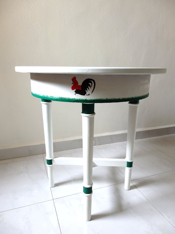 Lampang rooster table:   by Art From Junk Pte Ltd