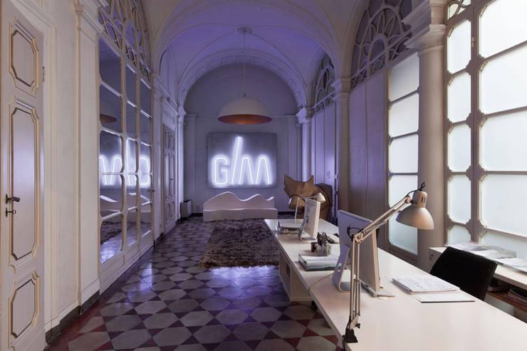 Estudios y despachos de estilo ecléctico de Giraldi Associati Architetti