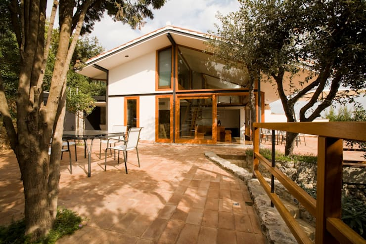 Villa ad Ansedonia II: Case in stile in stile Moderno di Studio Transit