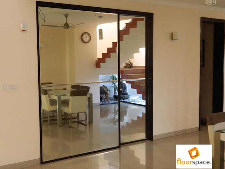 Project Encore - Mirror Wall Panel Work:  Houses by Floorspace