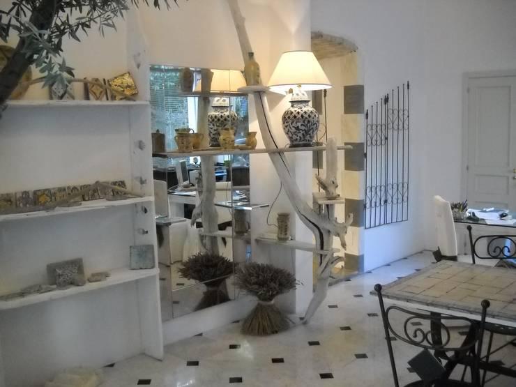 studio di progettazione d'interni: Negozi & Locali commerciali in stile  di INDUSTRIA DELL'ARTE,