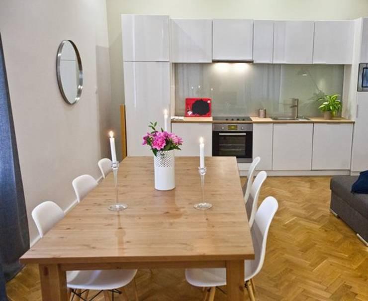 Espace repas: Salle à manger de style  par 3B Architecture