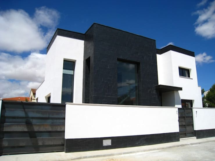 Vivienda 1109: Casas de estilo  de Estudio Dva Arquitectos S.l.p.