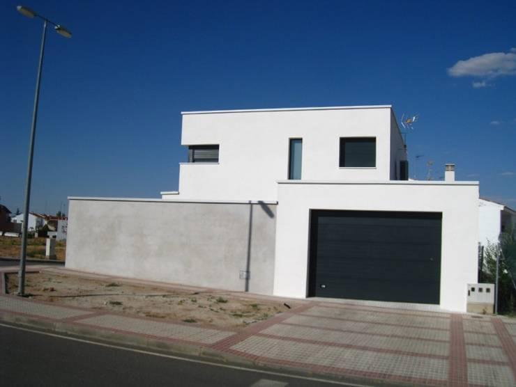 Vivienda 1034: Casas de estilo  de Estudio Dva Arquitectos S.l.p.