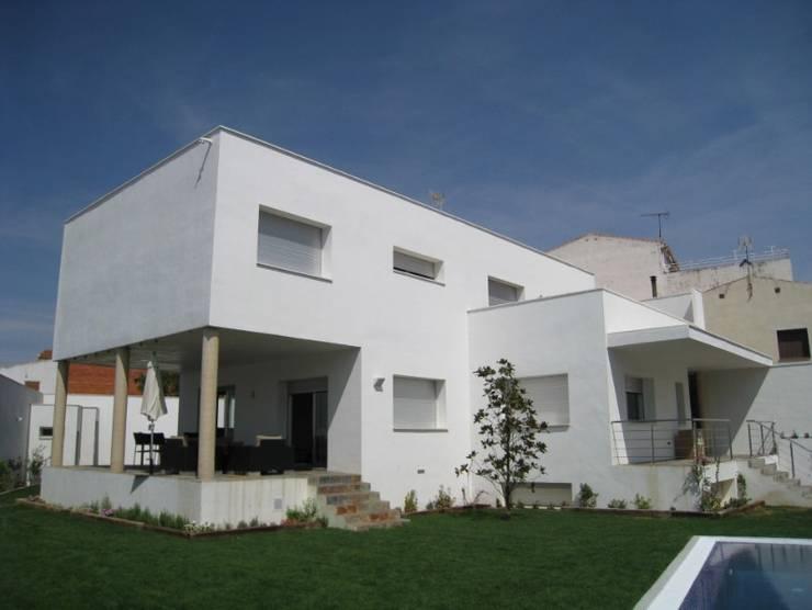 Vivienda 0709: Casas de estilo  de Estudio Dva Arquitectos S.l.p.