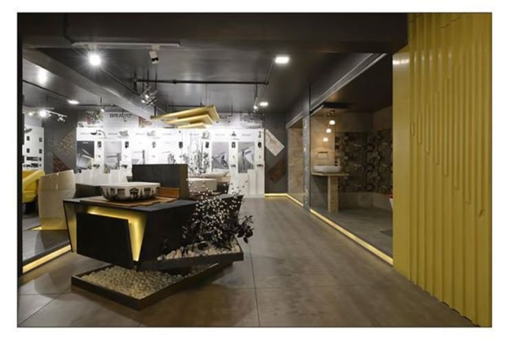 Rangoli Cera:  Office spaces & stores  by Eclectic Interiors