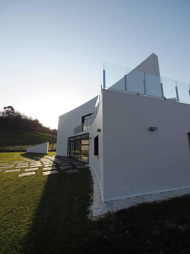 casa klip: Casas de estilo  de Erredeeme Arquitectos slp