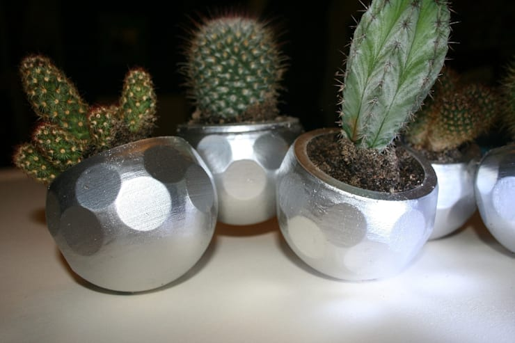 bubbles: Giardino in stile  di Architetto e Designer,