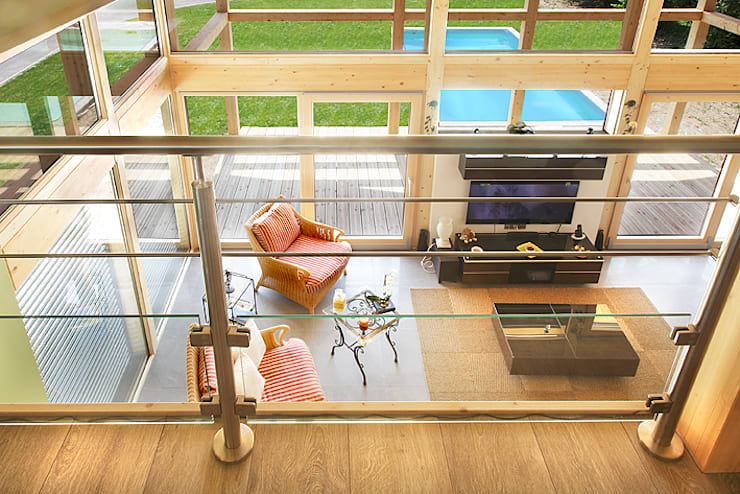 Maison bois poteau-poutre: Maison de style  par Myotte-Duquet Habitat