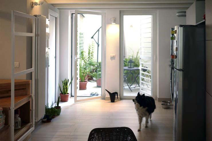 Casa CM: Finestre in stile  di Nicola Sacco Architetto, Industrial
