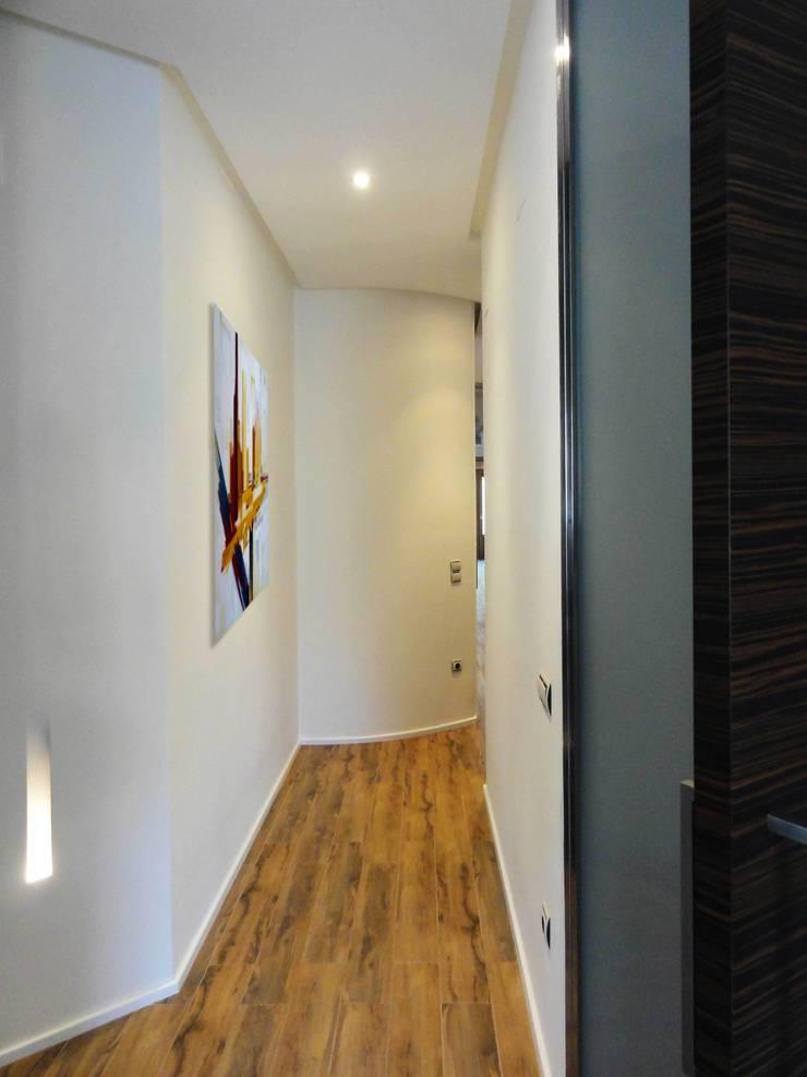 VIVIENDA EN ENSANCHE: Casas de estilo  de DECOR BUSIER INTERIORISMO