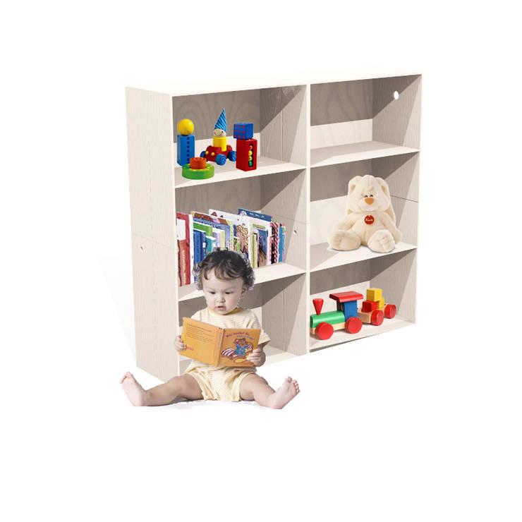 l'armadio dei libri e  dei giochi: Stanza dei bambini in stile  di Loop Landscape & Architecture Design