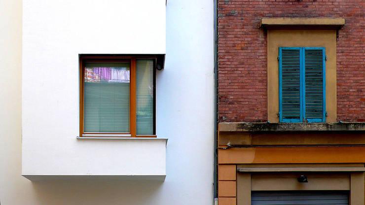 VIA PODGORA / VIA VITTORIO VENETO:  in stile  di Studio Giorgio Volpe