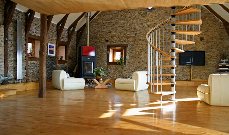 Barn in Chenailler Mascheix, France :  Living room by Capra Architects