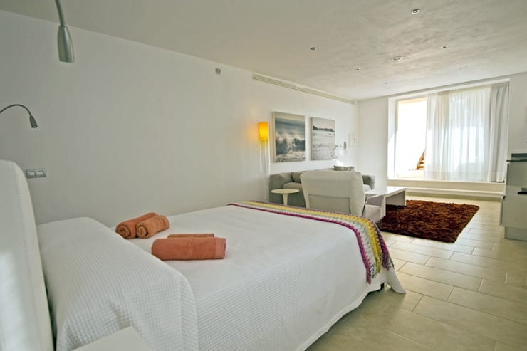Loft: Dormitorios de estilo moderno de Ivan Torres Architects