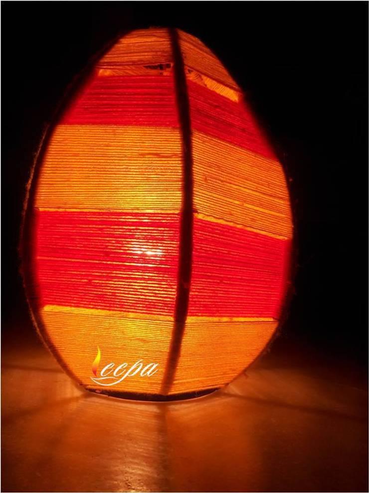 Hand woven Lamp: modern Living room by Deepaakula Design