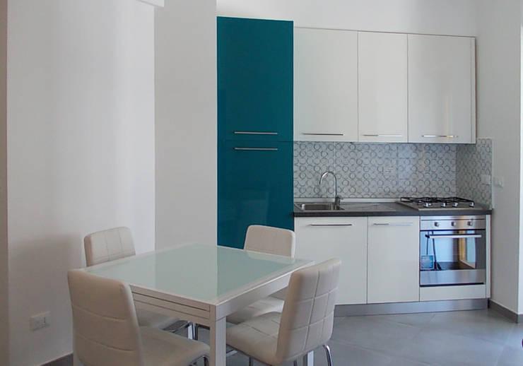 Pranzo-Cucina:  in stile  di Studio tecnico associato 'Il Progetto'