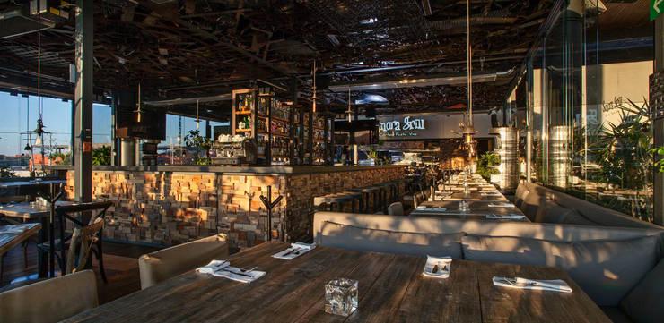 Sonora Grill Juriquilla:  de estilo  por Central de Arquitectura