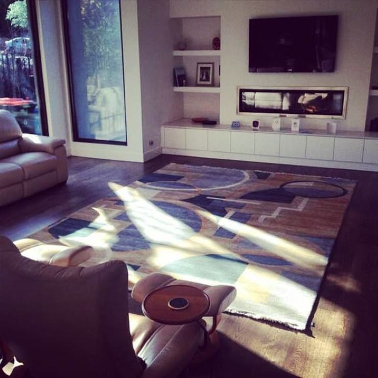 A beautiful Art Deco rug in a trendy living room!:  Artwork by Cocoon Fine Rugs