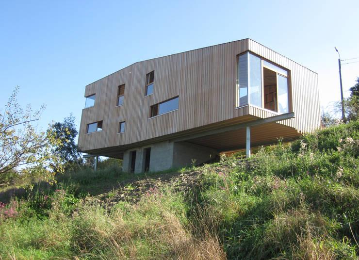 Casas de estilo  por Atelier Architecture Daniel Delgoffe