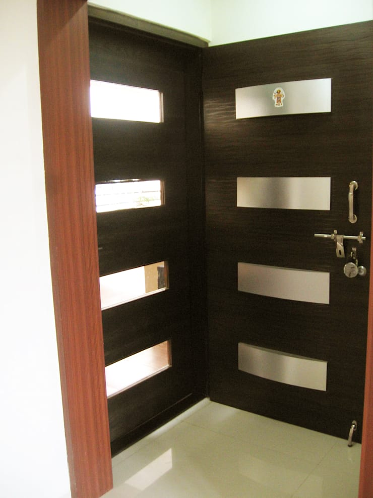ENTERANCE DOOR WITH SAFETY DOOR:  Corridor, hallway & stairs  by 4D The Fourth Dimension Interior Studio
