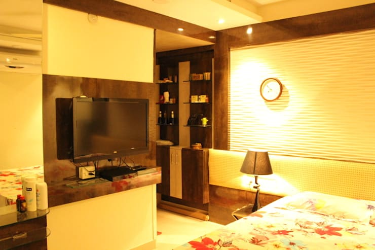 Classy Home In Upmarket bangalore:  Living room by Architecture Interior Co. Pvt. Ltd