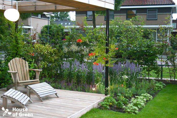 Vakantiehuis in eigen tuin: moderne Tuin door House of Green
