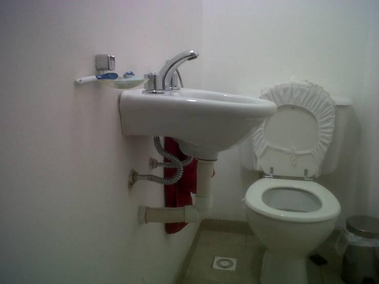 remodelacion de toilette:  de estilo  por Remodelaciones SF