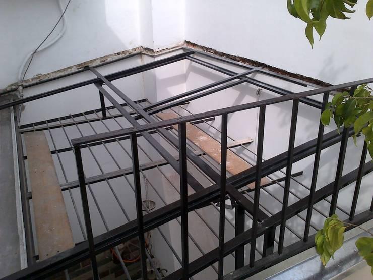 remodelacion de terraza:  de estilo  por Remodelaciones SF