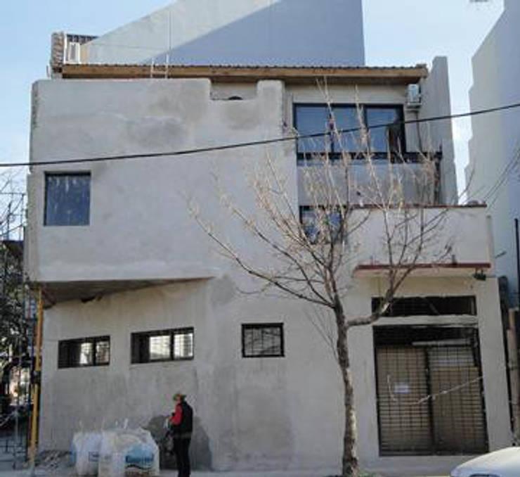 ampliacion de vivienda unifamiliar y estudio contable:  de estilo  por Remodelaciones SF