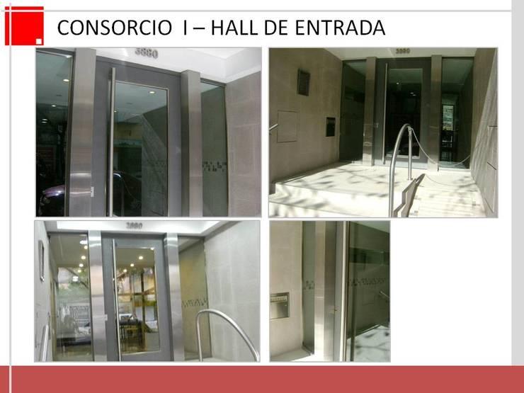 Remodelacion de hall de entrada de edificio. CABA:  de estilo  por Remodelaciones SF