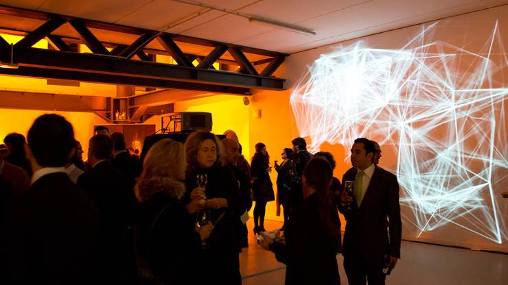 PREMIUMFEST BILBAO DIGITAL CONTENT LIGHT ART: Espacios comerciales de estilo  de Lighting Design Collective S.L.