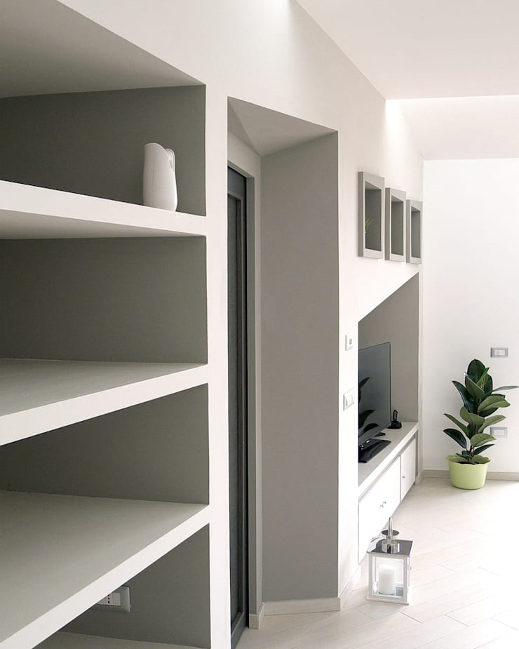 Zona living: pieni, vuoti luci ed ombre: Case in stile  di STUDIO LAR, Moderno