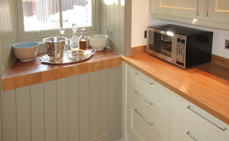 End Grain Worktops in a highland kitchen:  Kitchen by NAKED Kitchens