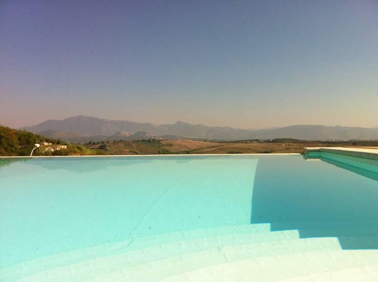 Villa T:  in stile  di 3c+t Capolei Cavalli architetti associati,