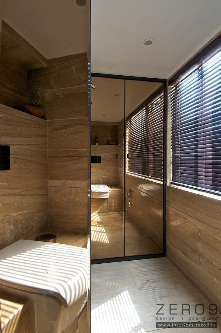 mirror bathroom:  Houses by ZERO9