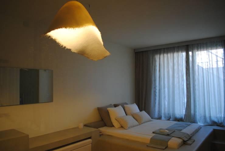 Vista della Camera da letto padronale: Piscine in stile  di Silvia Cassetta kNoWarchitecture,