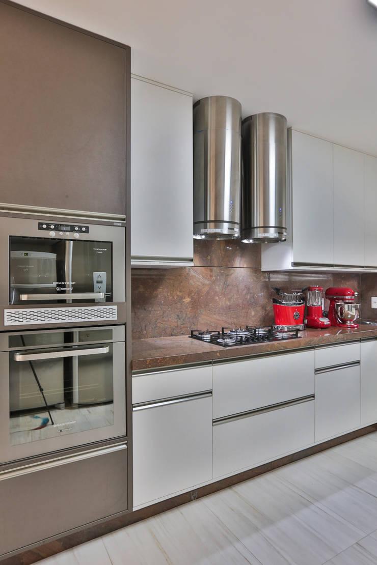 Cozinha modulada bonita e funcional: Cozinhas  por Rita Albuquerque Arquitetura e Interiores