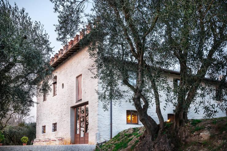 Casas de estilo rural de Studio Athesis