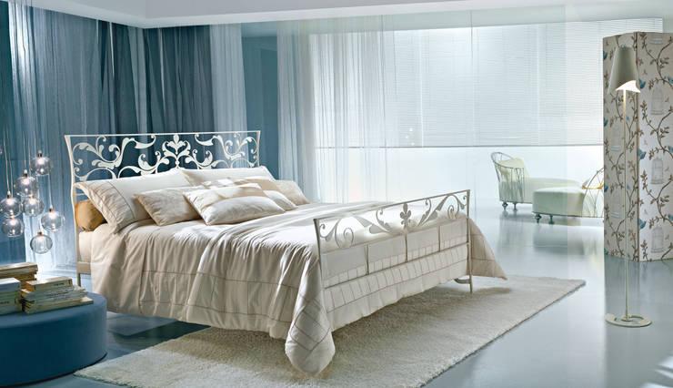 Dormitorios de estilo  por Ciacci
