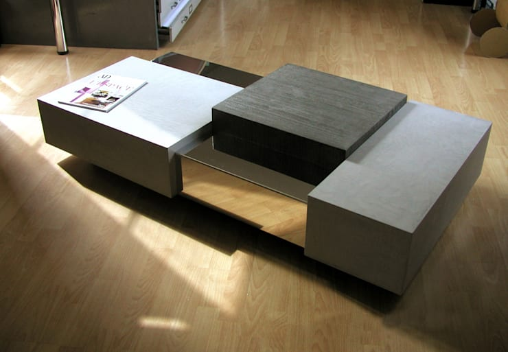 Table basse béton + métal: Salon de style  par Cameleon design