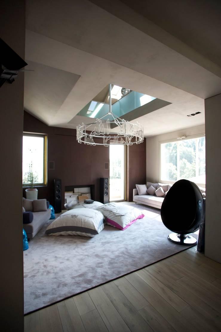 GARDEN ROOF HOUSE: Casa in stile  di MetroArea Architetti Associati,