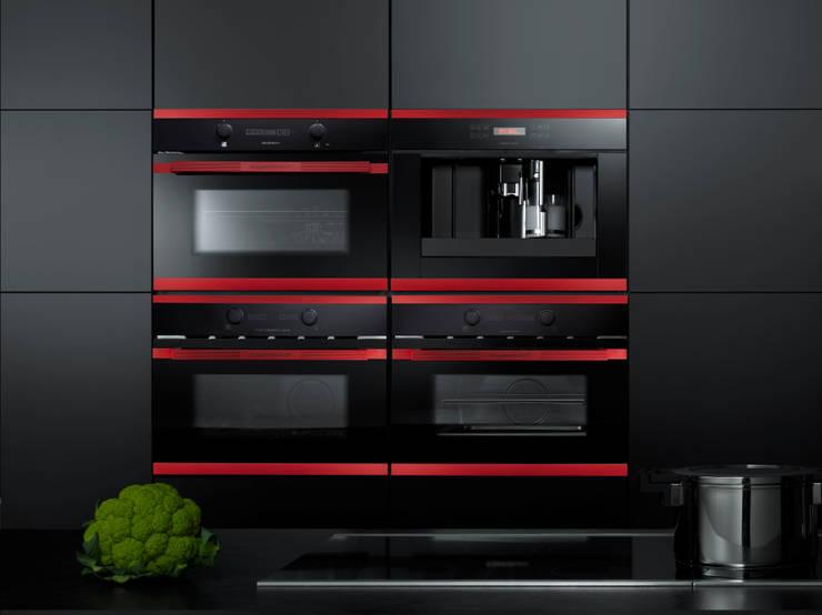 Cucina in stile in stile Moderno di Küppersbusch Hausgeräte GmbH