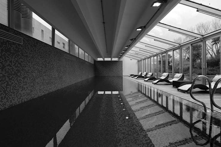 RAINBOW Imagination factory: Piscina in stile  di Studio Bianchi Architettura